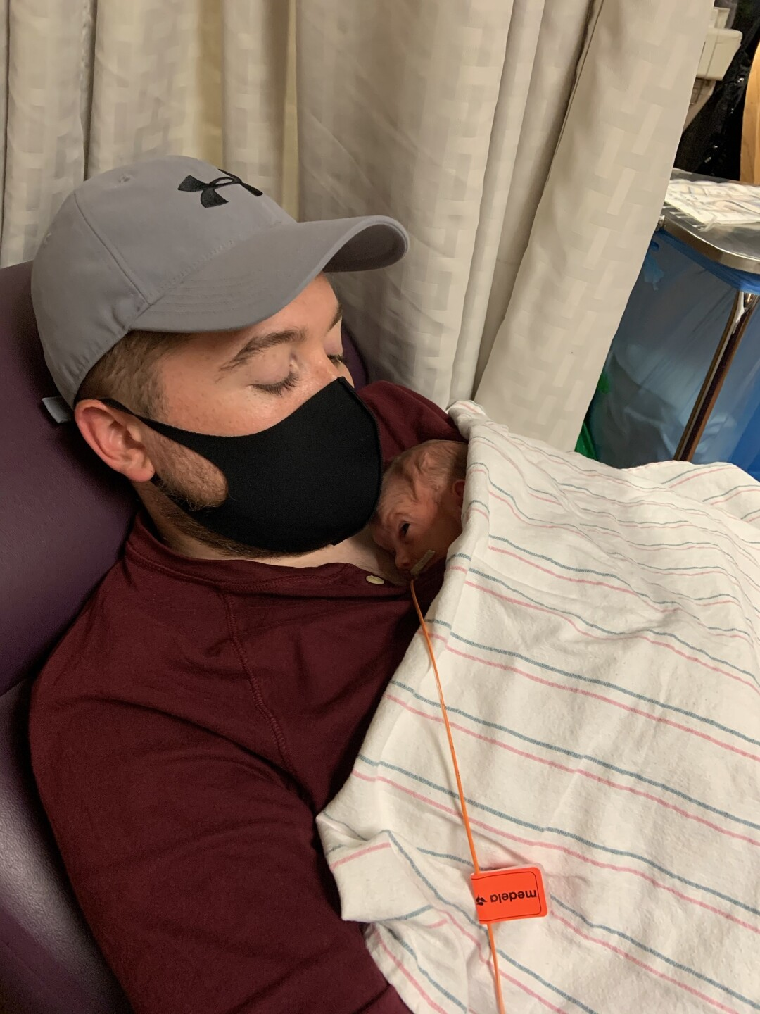 Noah Hickman holds one of his triplet daughters at Abrazo Arrowhead Campus' NICU unit.