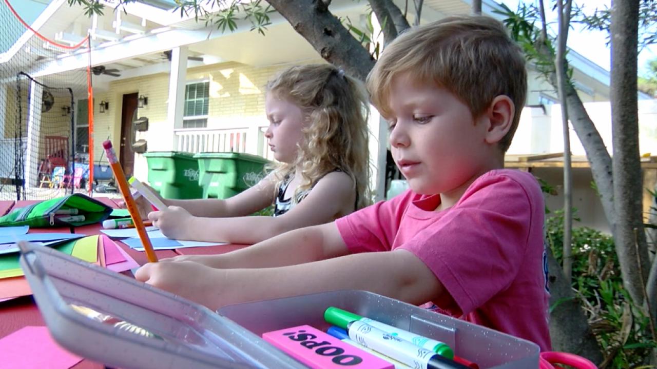 kindergarten students making cards