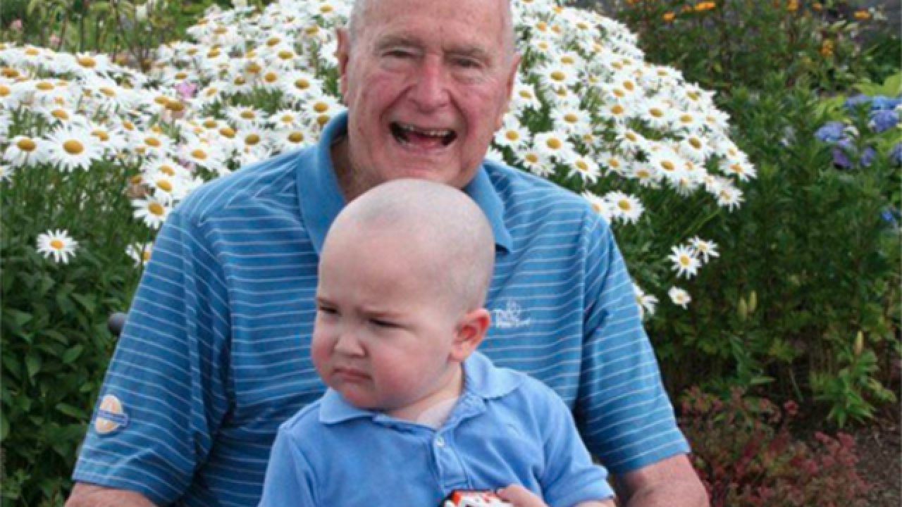 George H.W. Bush shaves head for child with leukemia