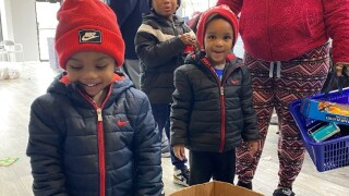 Kids line up to pick out toys at the Plush Cuts Barbershop in Hamilton.jpg