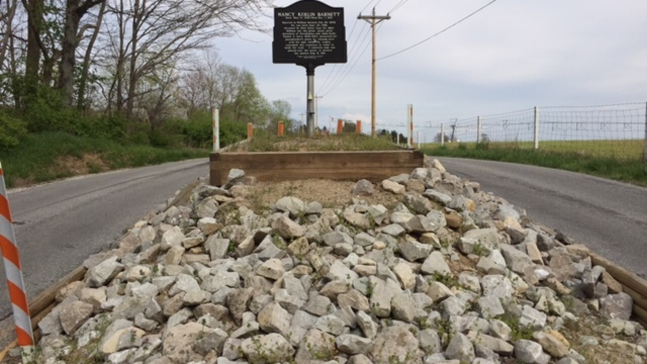 PHOTOS: Historic grave in Johnson County road