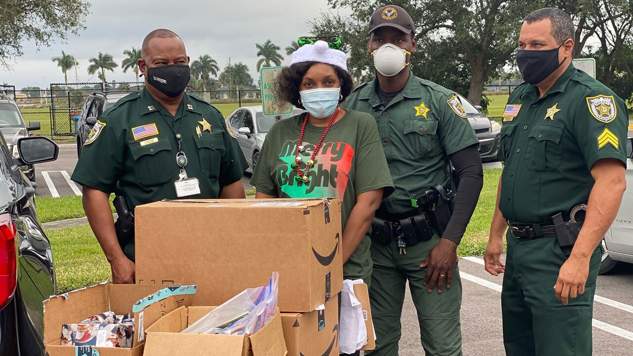 Palm Beach County deputies helped deliver holiday gifts after a bus crashed Dec. 17, 2020.