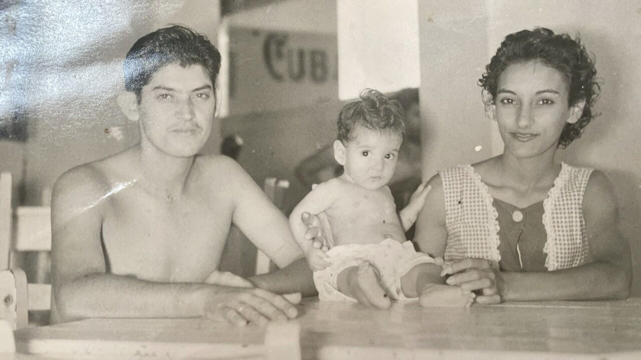 Cuban refugee Reinaldo Rodriguez in Cuba with his wife and daughter late 1950's.