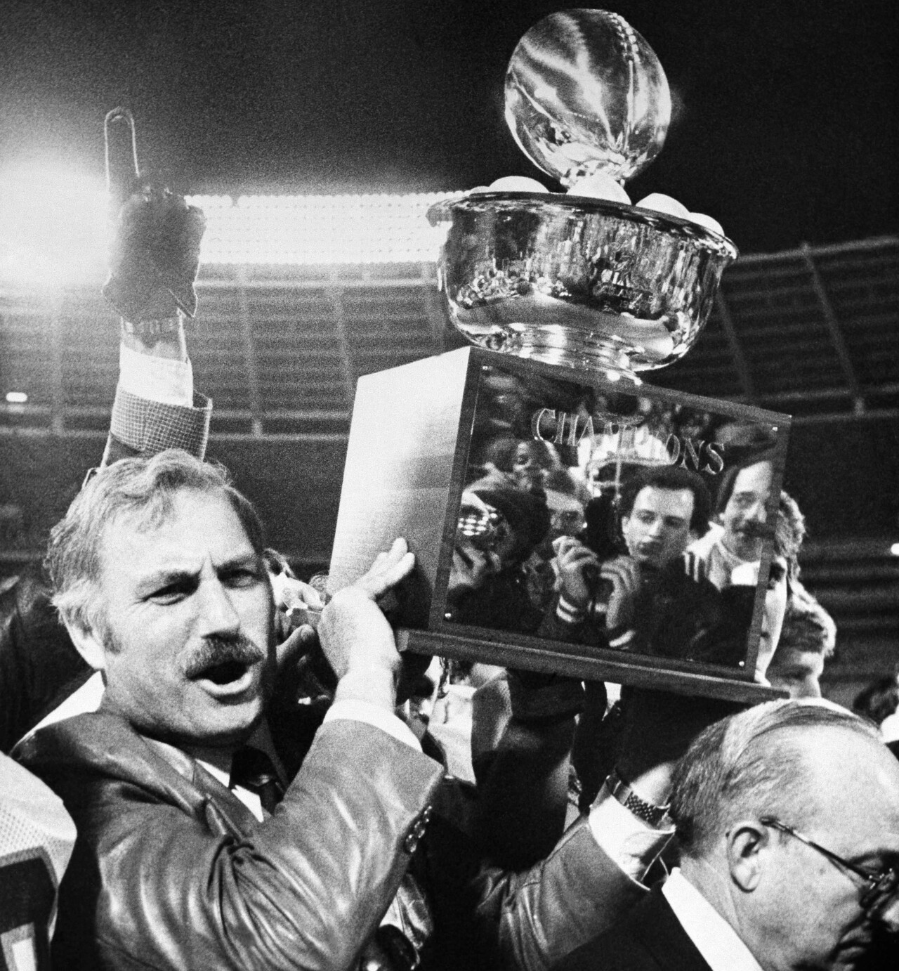 Miami Hurricanes head coach Howard Schnellenberger celebrates after 1981 Peach Bowl