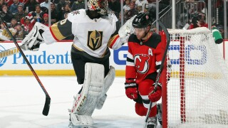 NEWARK, NEW JERSEY - DECEMBER 03: Malcolm Subban #30 of the Vegas Golden Knights argues a goal by Jesper Bratt #63 of the New Jersey Devils (not shown) during the second period as Taylor Hall #9 of the Devils fell into the net at the Prudential Center on December 03, 2019 in Newark, New Jersey. (Photo by Bruce Bennett/Getty Images)