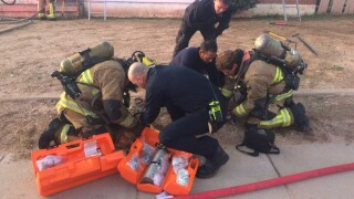 Flores House Fire Dog CPR