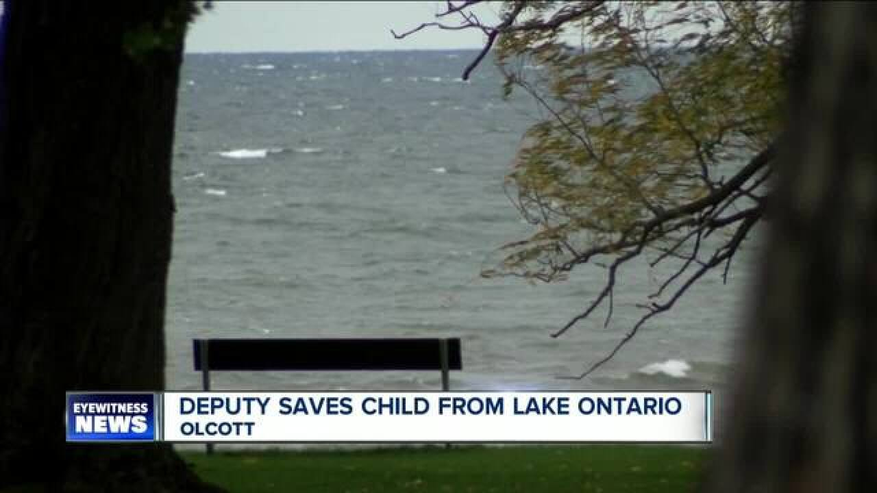 Child rescued from Lake Ontario, father charged