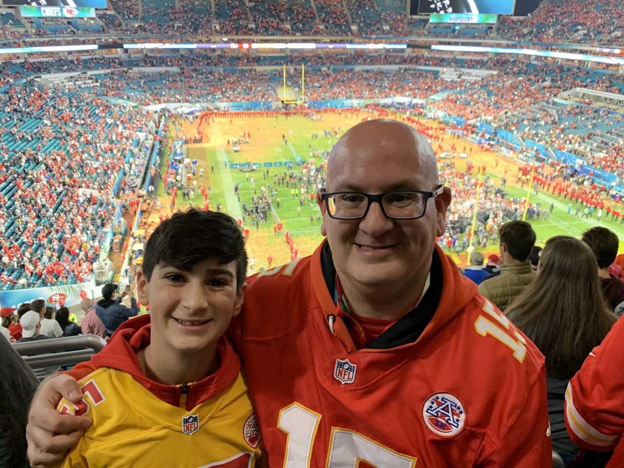 Jassey and son at Chiefs game