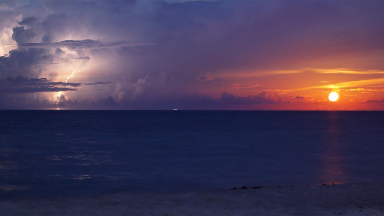 WPTV photojournalist Kaan Pala was in the right place at the right time July 17, 2019 to capture a lightning strike alongside a moonrise off the coast of Jupiter, Fla.