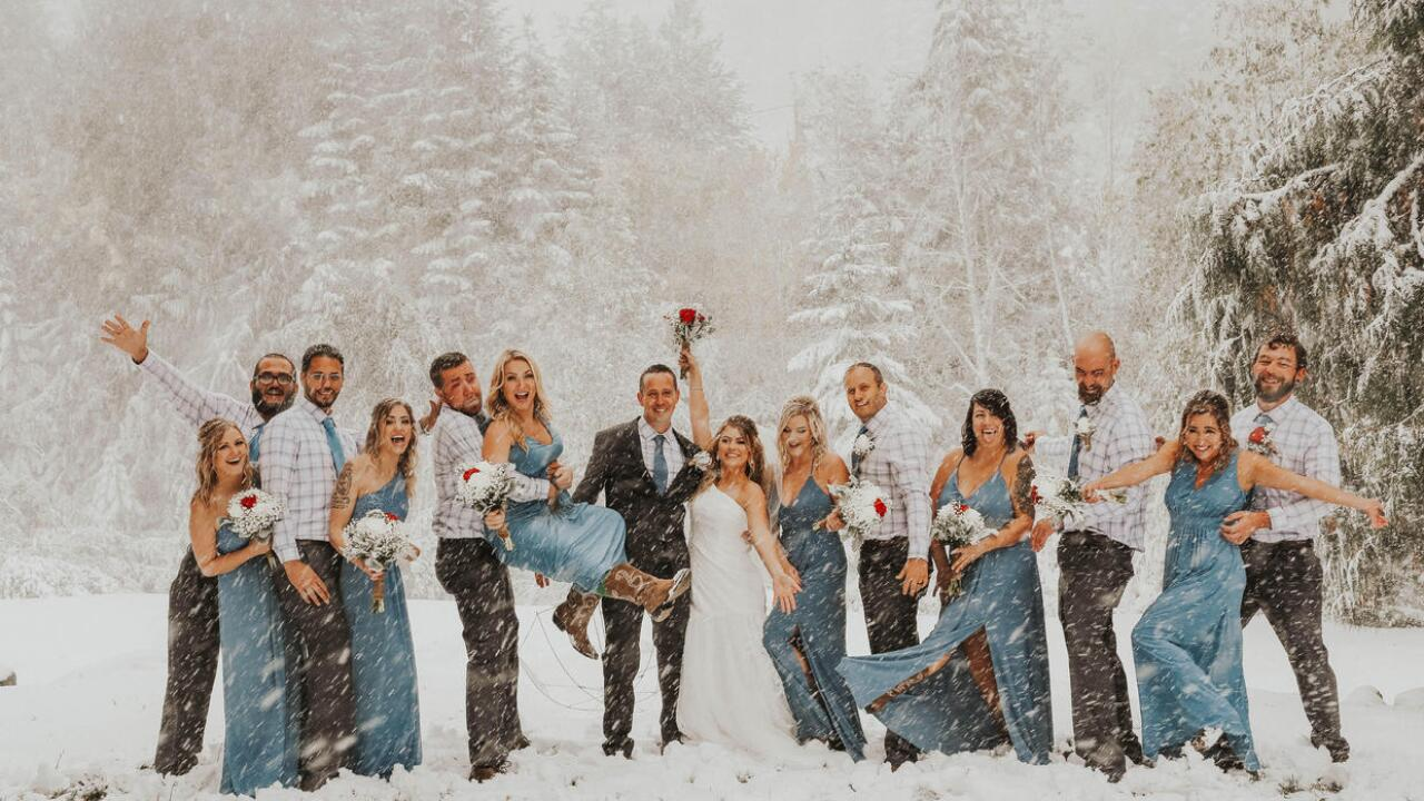 Surprise snowstorm serves as beautiful backdrop for couple's 'fall' wedding