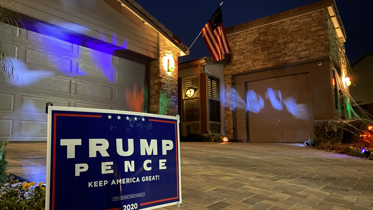 A Las Vegas homeowner says a someone stole campaign signs out of their yard and then returned to set fire to the American Flag.