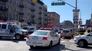 Scene after a person was injured in a shooting in Washington Heights