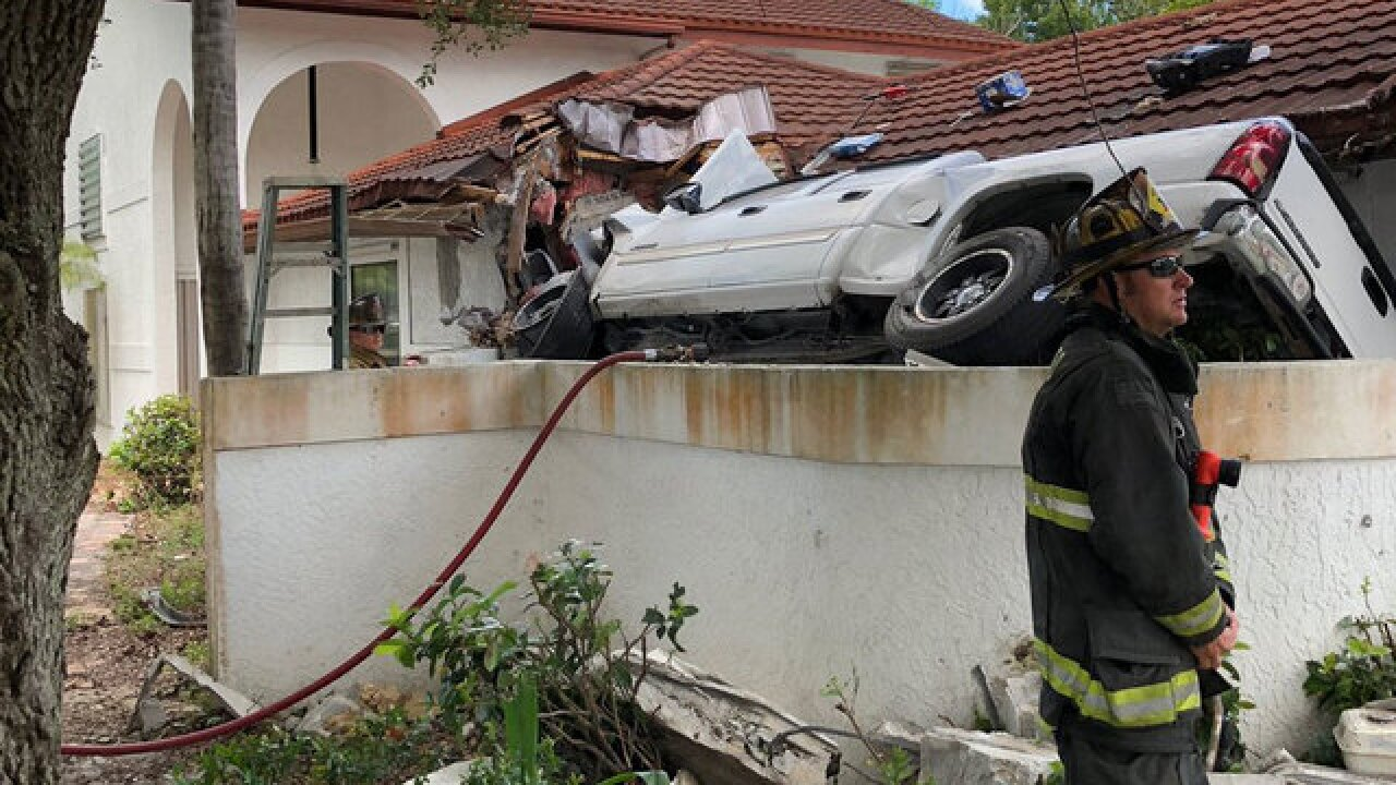 Truck crashes into Fort Pierce house