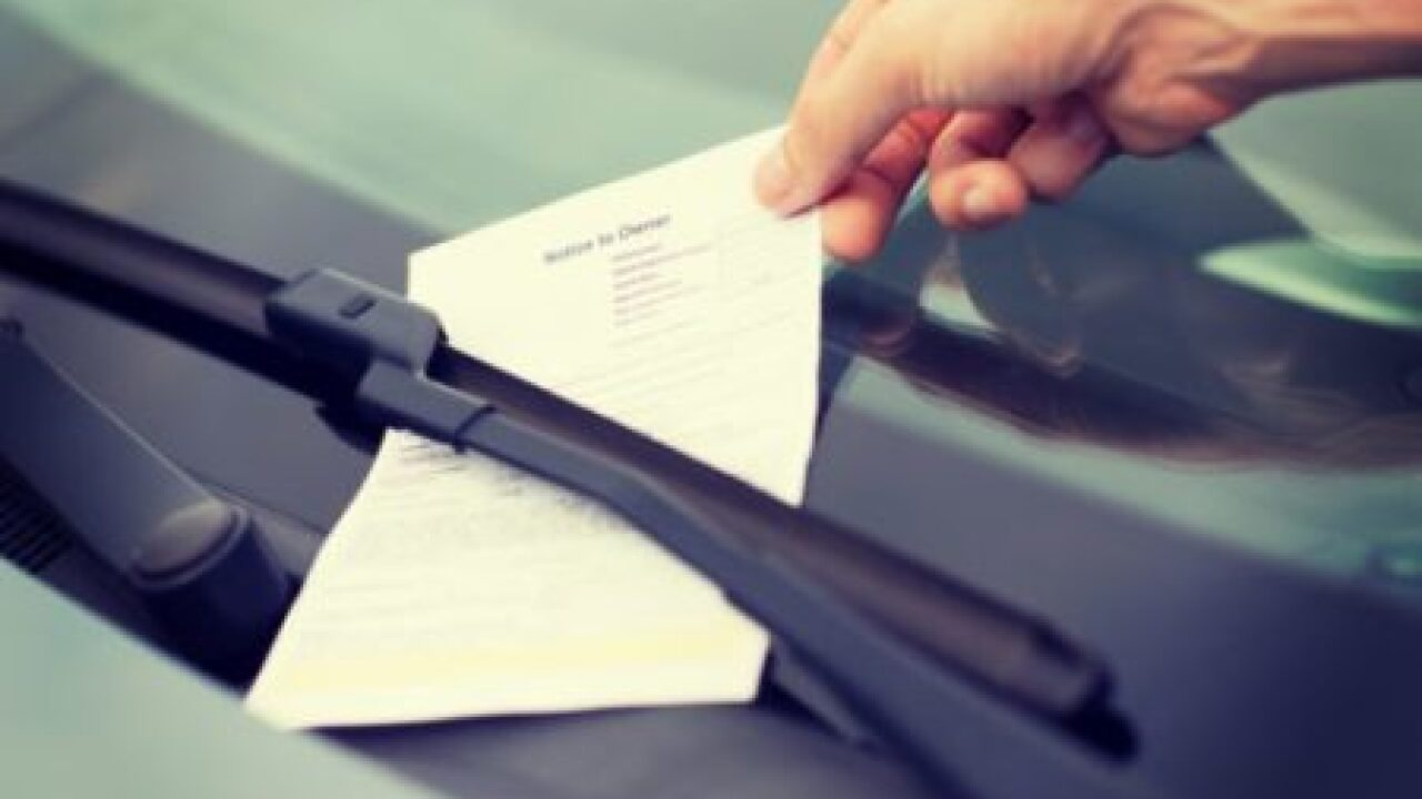Parking ticket attached to windshield