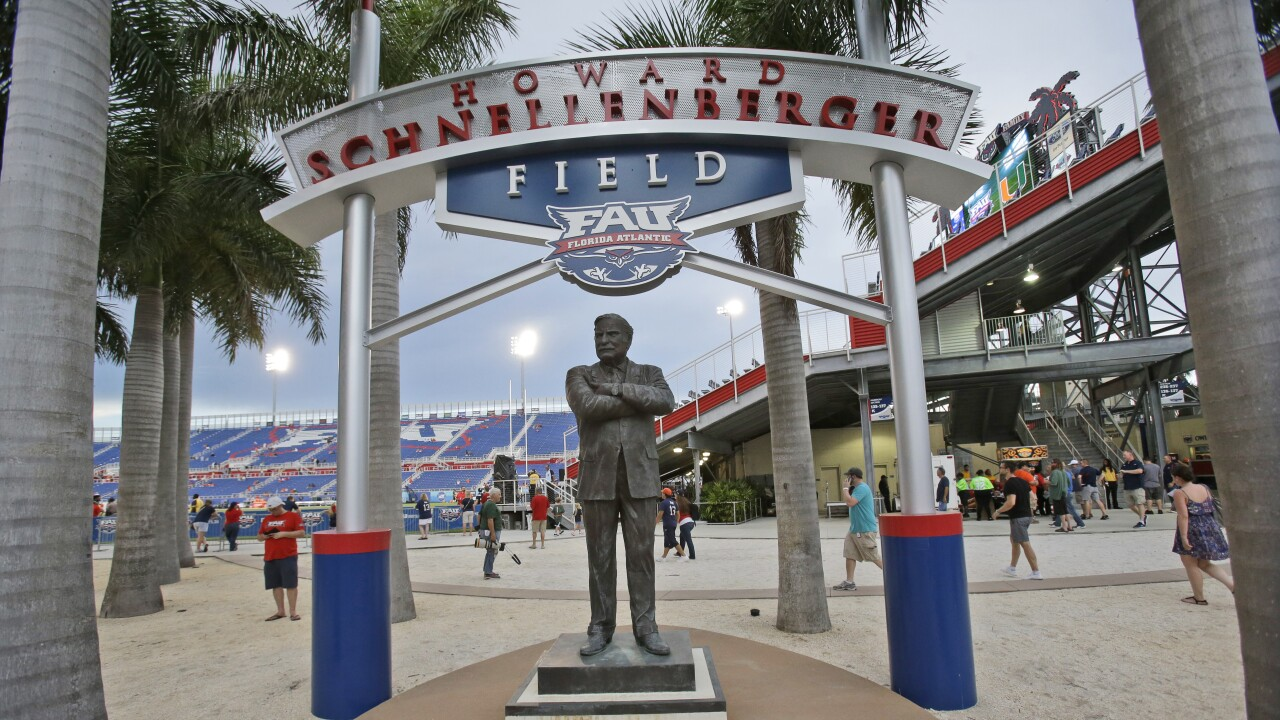 Statue of Howard Schnellenberger at FAU Stadium outside sign for Howard Schnellenberger Field in 2015