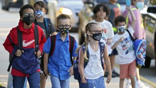 Children wear masks on first day of school at Sessums Elementary School in Riverview, Fla., Aug. 10, 2021