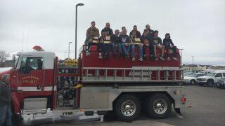 Manhattan Christian celebrates boys basketball state championship with firetruck ride
