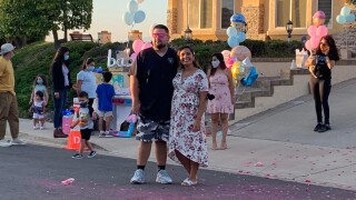 Paola and Jose at their summer gender reveal