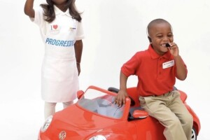 Harper Lynn with her friend Maurice dressed as Flo from Progressive and Jake from State Farm
