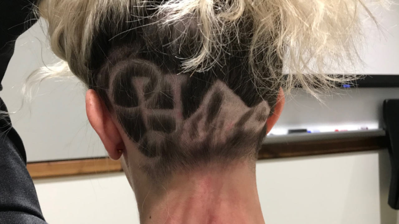 New Cottonwood Heights City Council Member shaves city's logo into her head