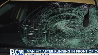Man hit after running in front of car in Spring Valley