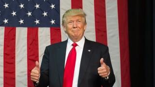 Donald Trump speaks near Lansing