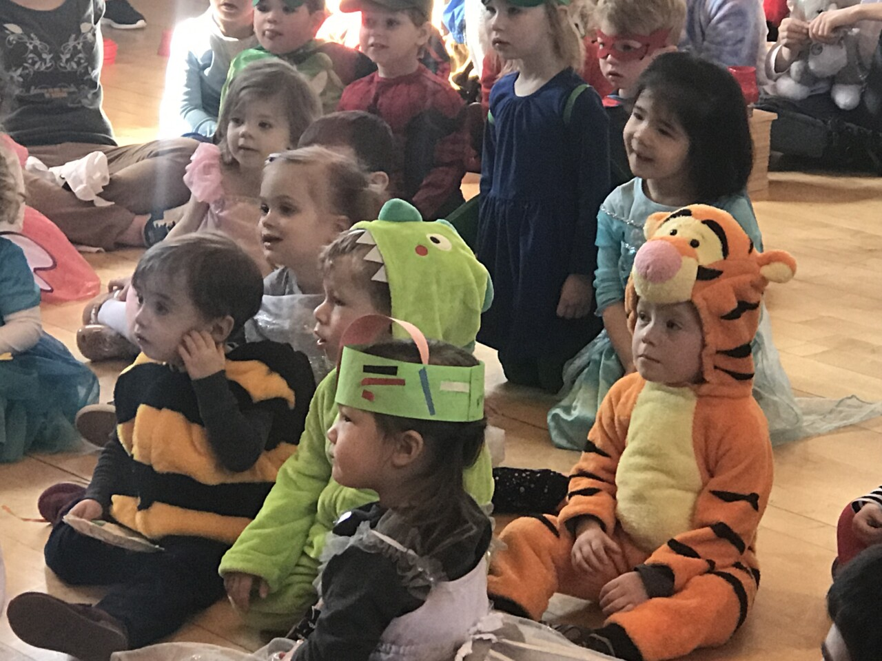 Children in costume listen to the story of Purim at the Harry and Rose Samson Family JCC in Whitefish Bay.
