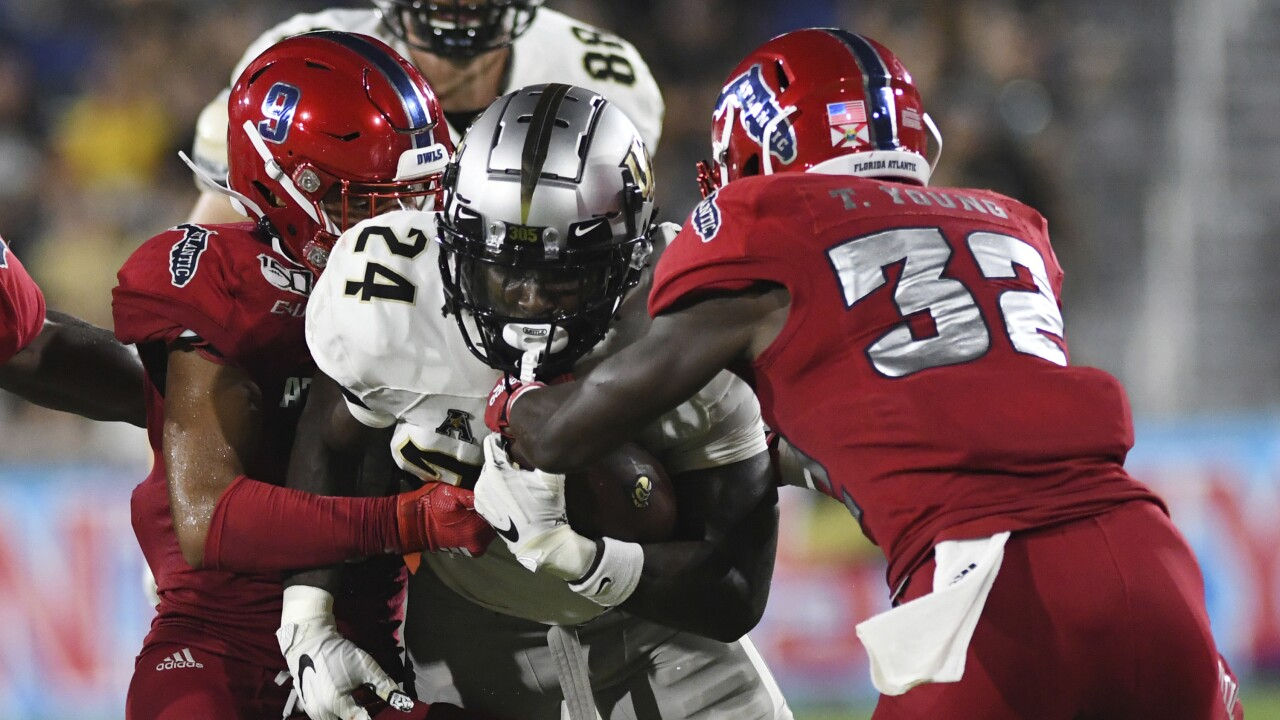 FAU Owls safety Quran Hafiz tackles UCF Knights Bentavious Thompson in 2019