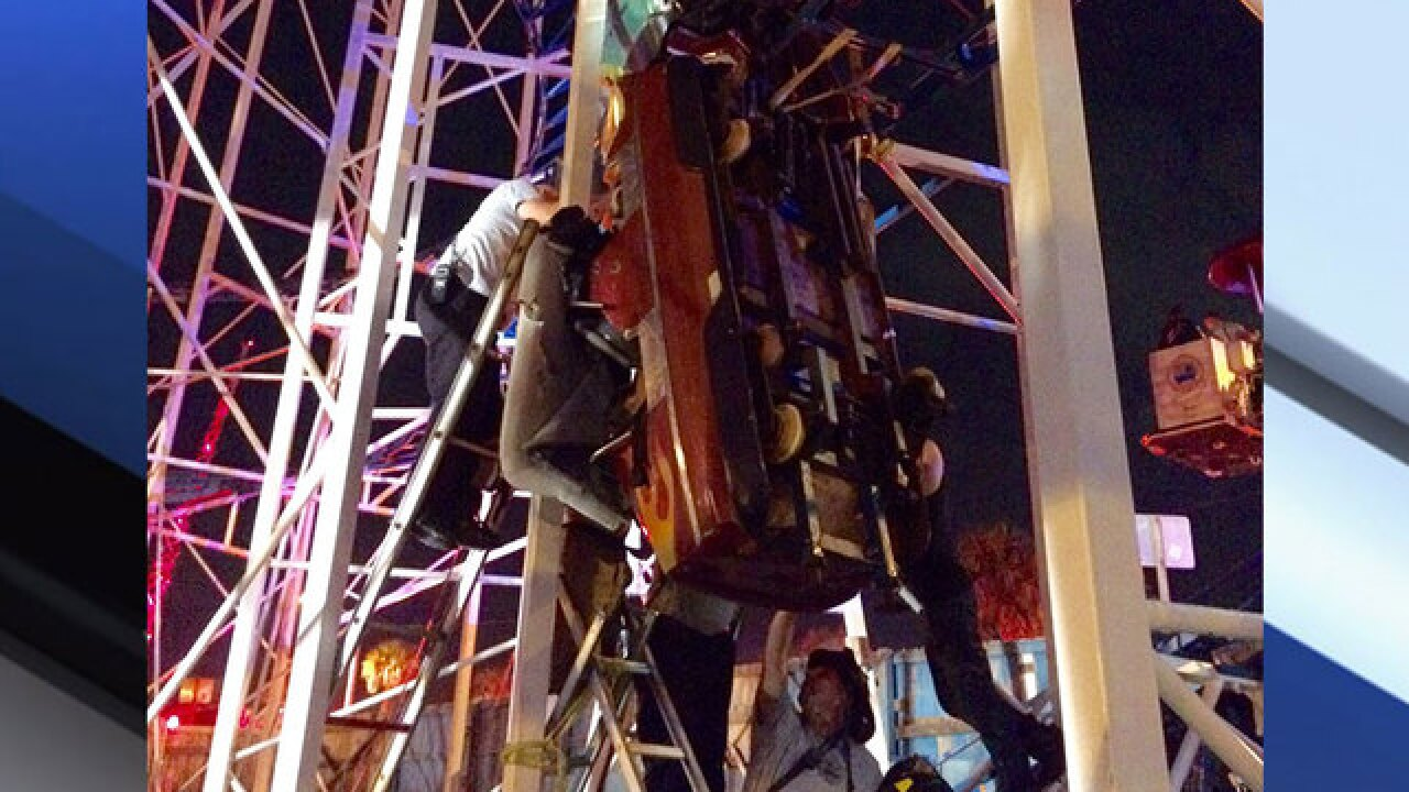 Riders fall 34-feet to the ground from dangling rollercoaster car in Florida