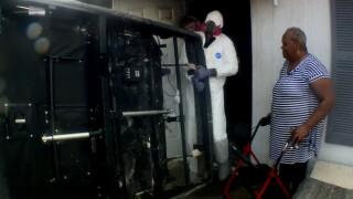 Winni Albury surveys fire damage to her home on Oct. 22, 2021.jpg