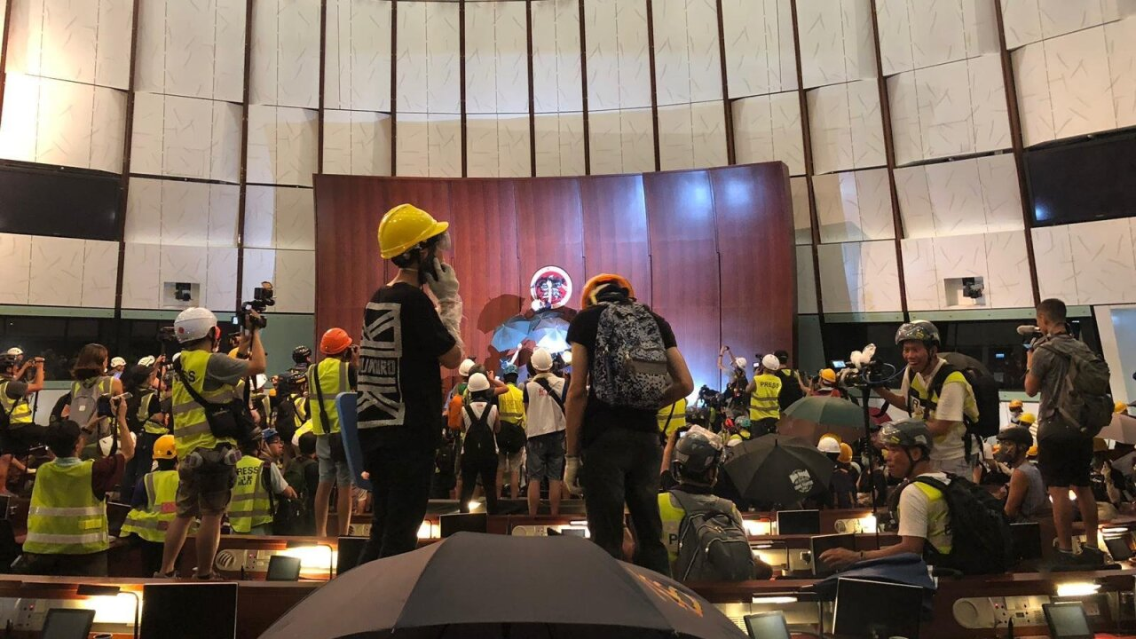 Hong Kong protesters storm government headquarters, break into legislative chamber