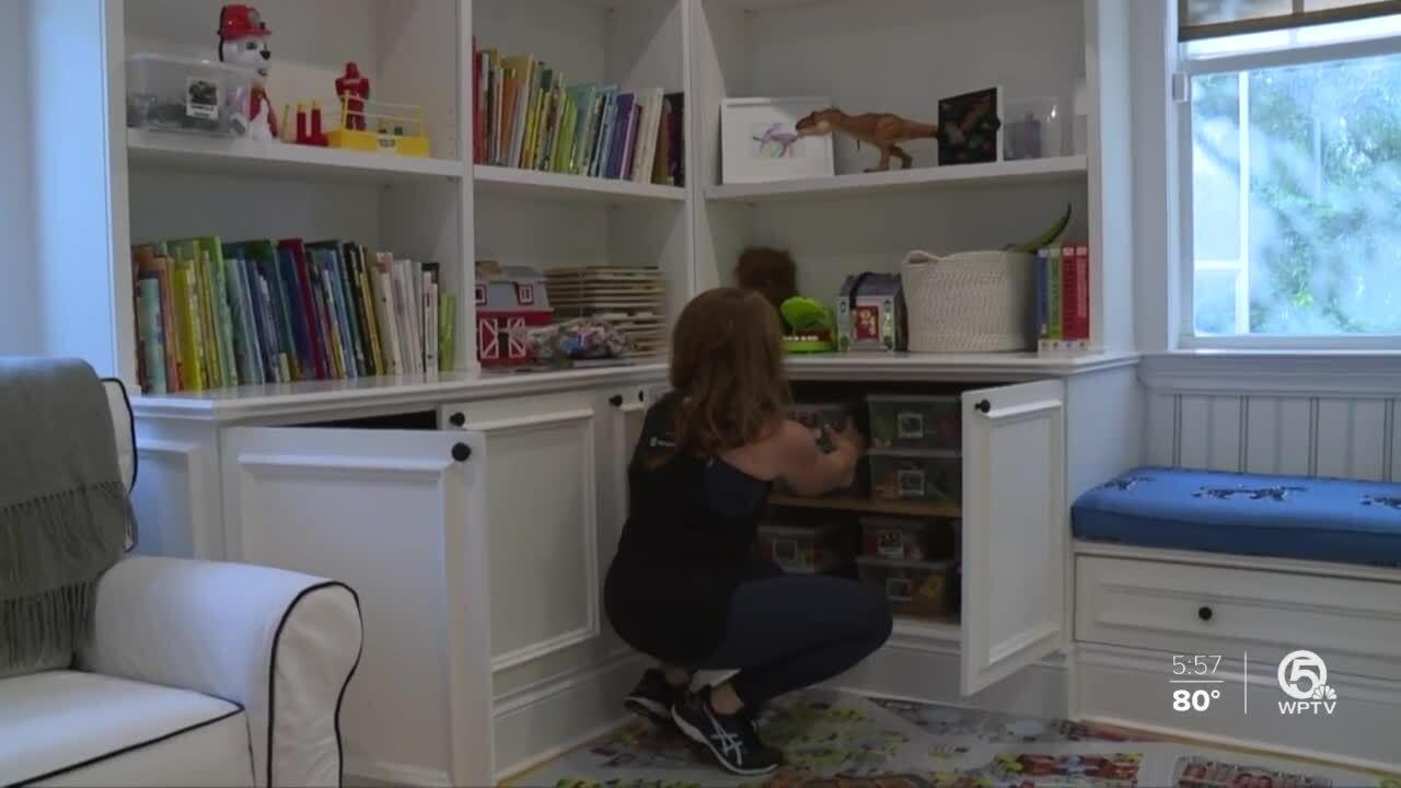 Jessica McGillicuddy organizes her child's toys