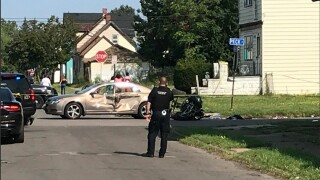 Car and ATV collide on city street