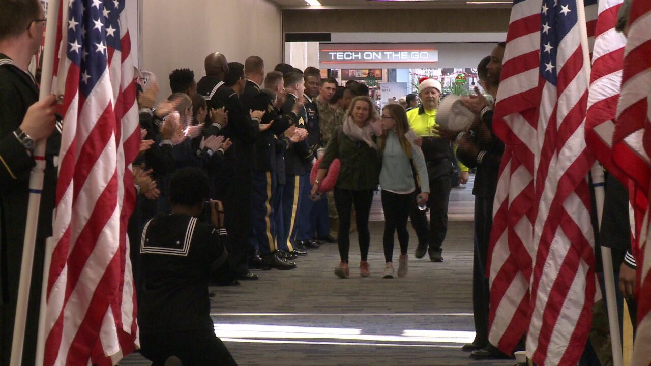Volunteers help local Gold Star families board 'Snowball Express' at Norfolk International Airport