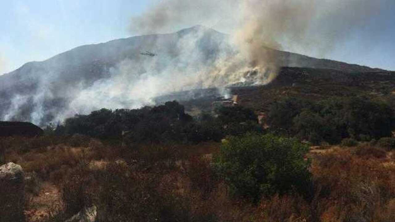 Smoke from brush fire visible near border