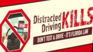 wptv-texting-while-driving-kills-sign.jpg