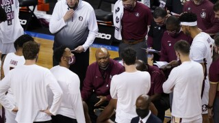 Florida State Seminoles head coach Leonard Hamilton talks to team in 2021 ACC Tournament Championship