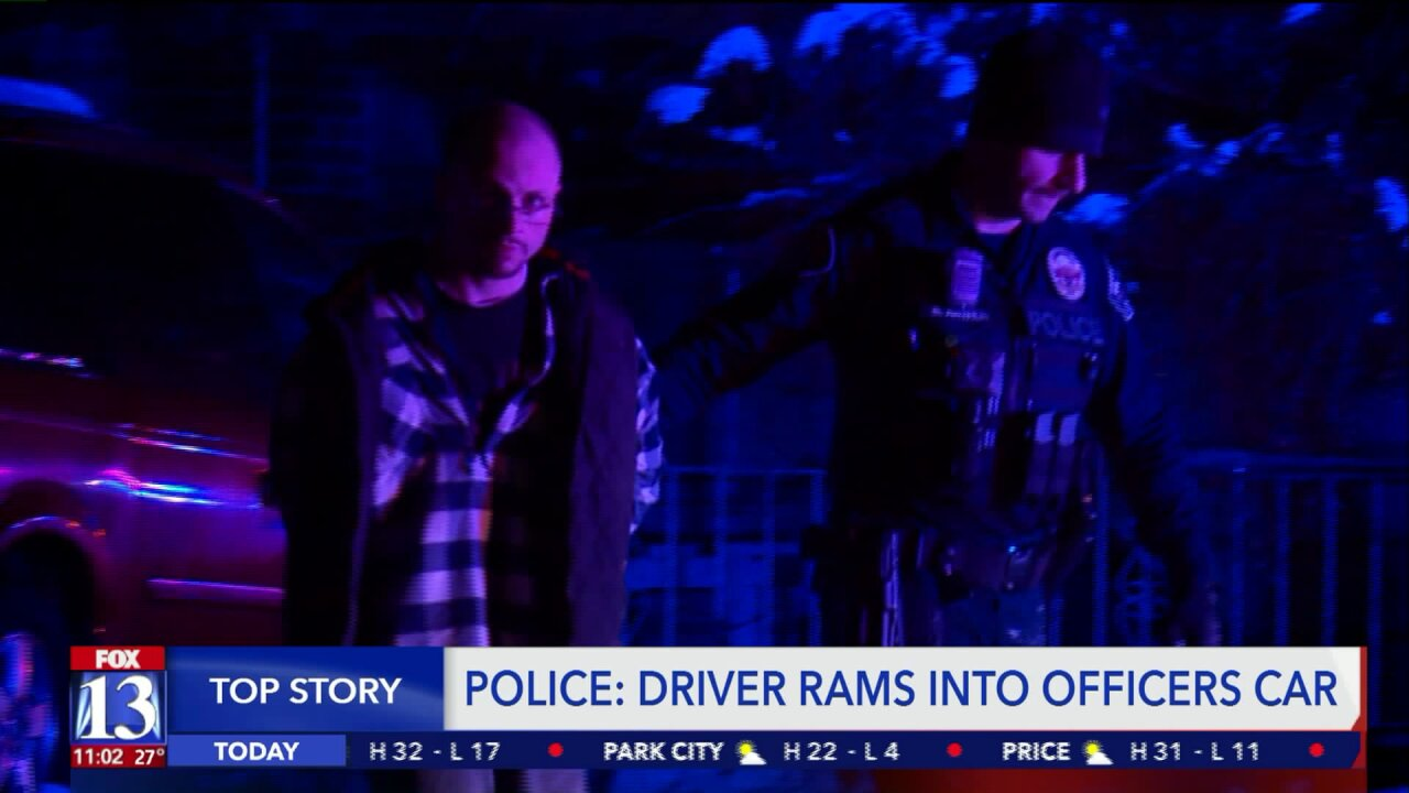 Officer tries stopping a car in West Valley City, but the driver rams his carinstead