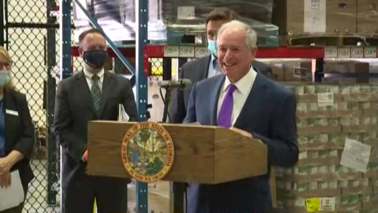 Stephen Schwarzman smiles at Palm Beach County Food Bank news conference, April 22, 2021