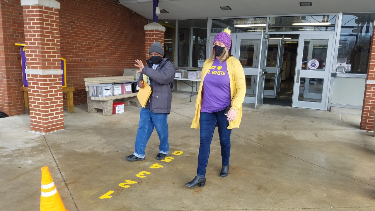 2) Mr. White leaving the AELC with Principal Colleen Mudore.jpg