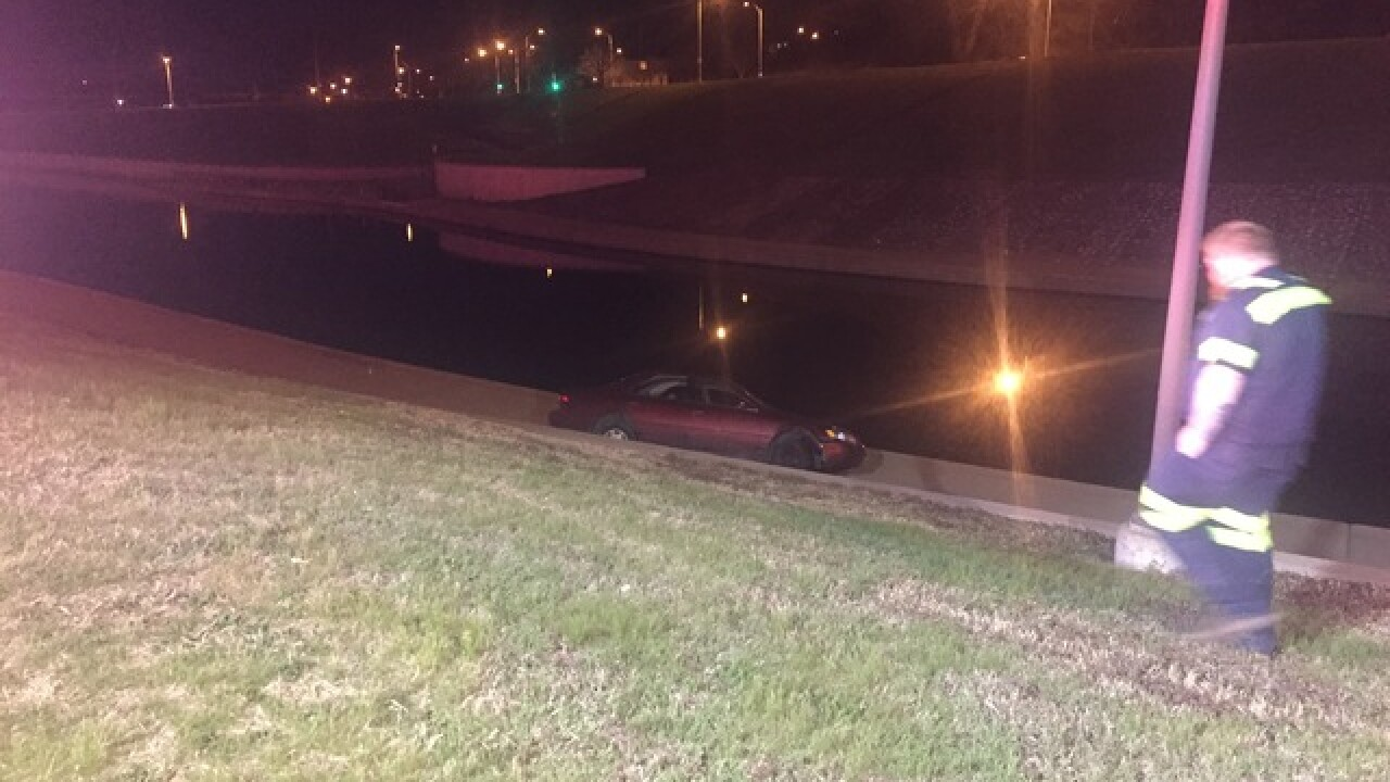 Car off roadway nearly enters Brush Creek