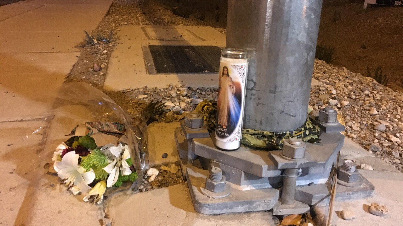 A roadside memorial is set up to remember a life lost at Blue Diamond and Lindell