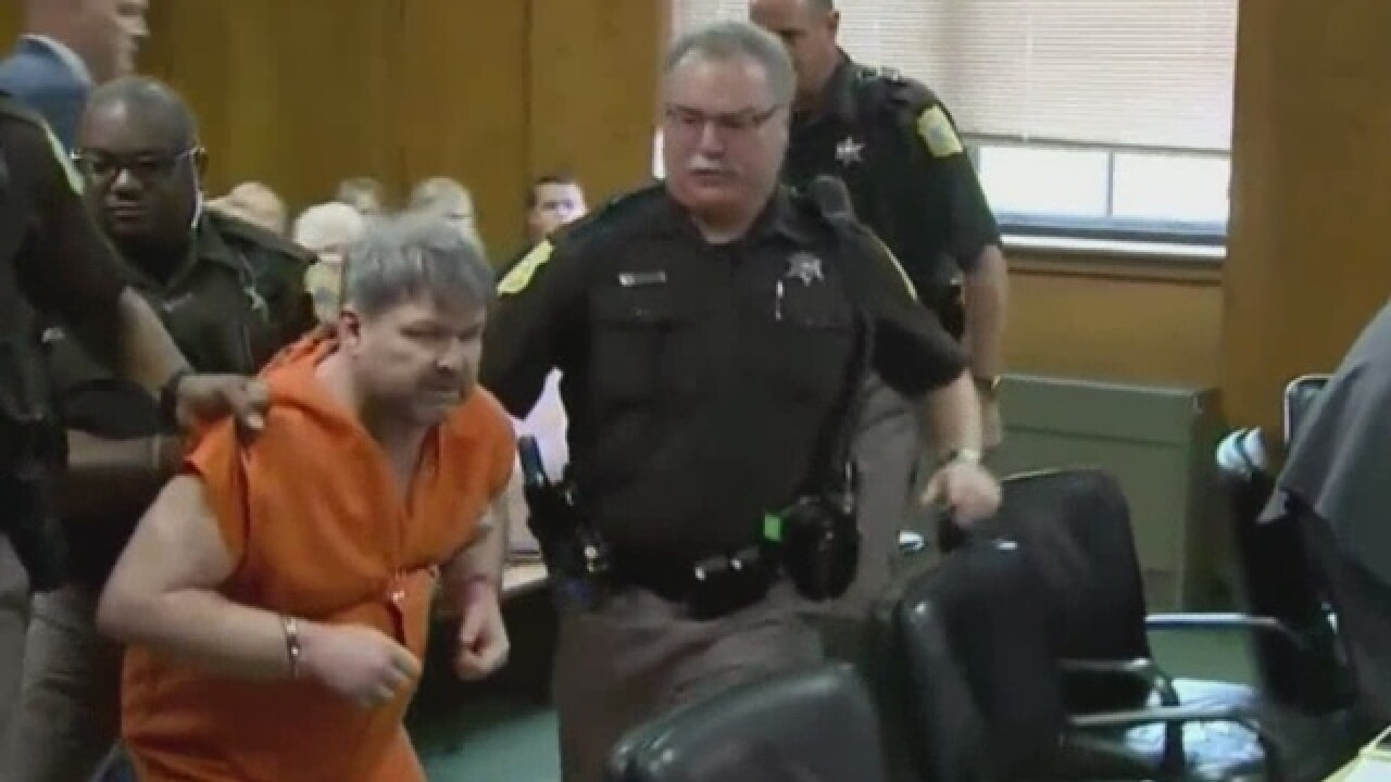 Kalamazoo shooting suspect dragged out of court