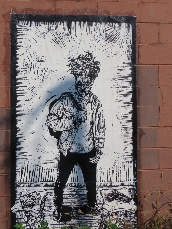 A portrait mural by local artist Watie White in Benson.JPG