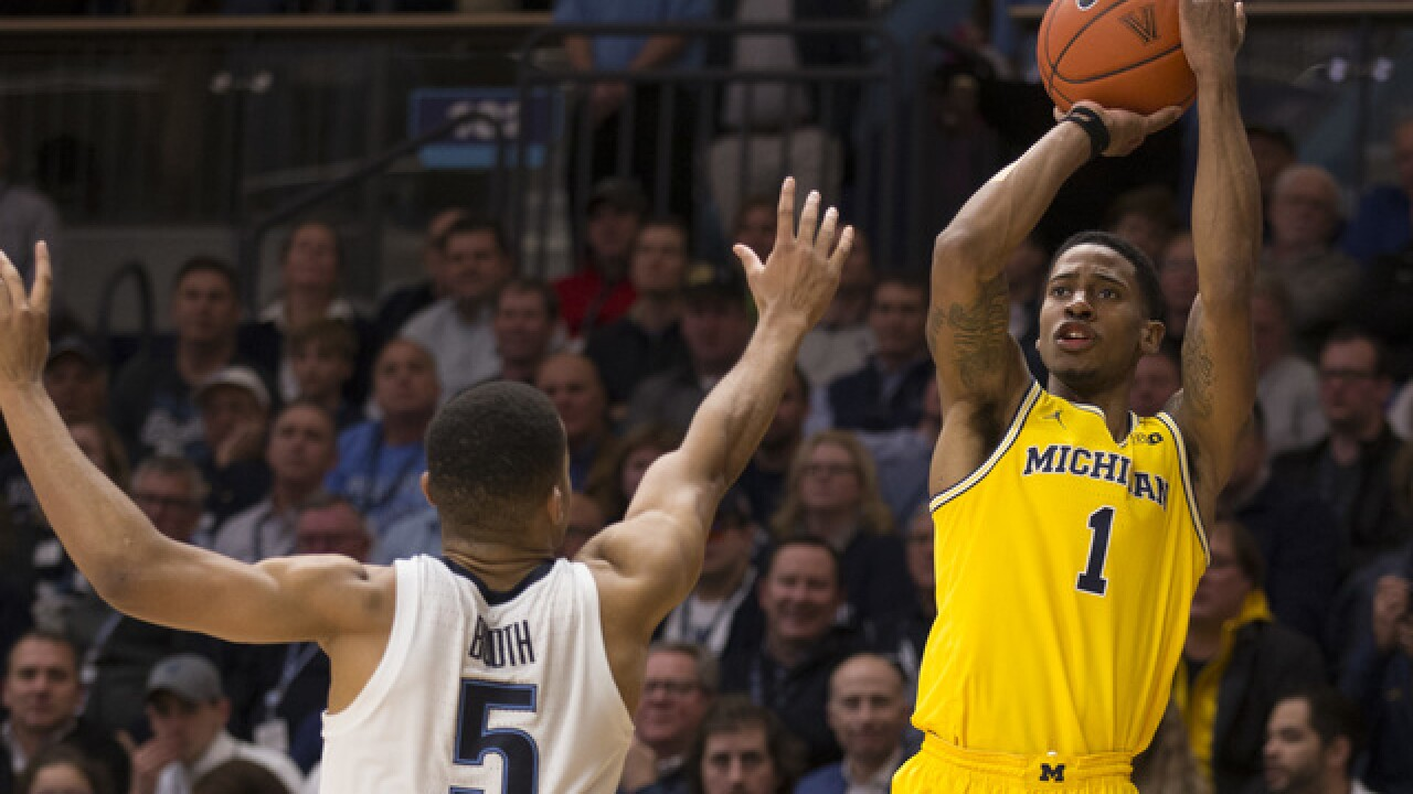 No. 18 Michigan routs George Washington in Tip-Off tournament