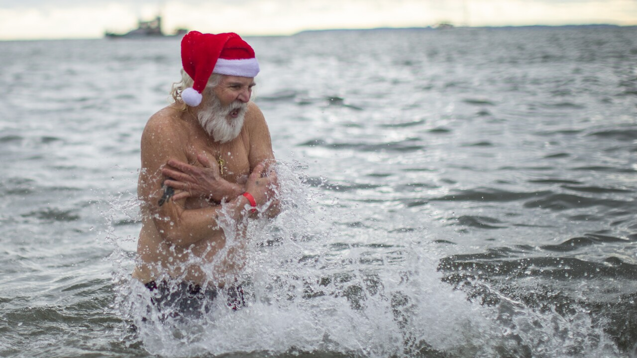 People Brave Frigid Waters For The Annual Polar Bear Swim At Coney Island