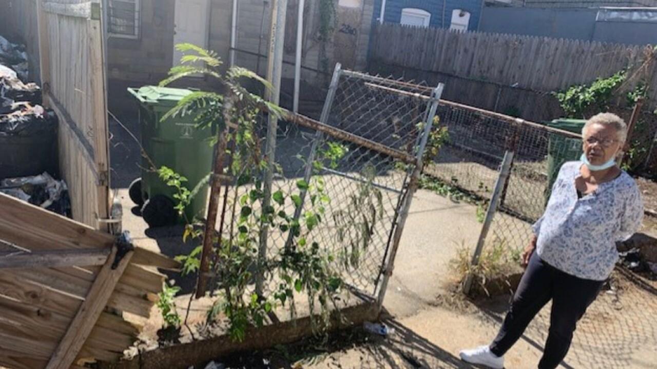 Woman says Baltimore City sanitation truck demolished her fence.jpg