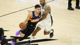 The Phoenix Suns have never been closer to an NBA title. Devin Booker scored 31 points, Chris Paul had 23 and the Suns beat the Milwaukee Bucks 118-108 on Thursday night to take a 2-0 lead. AP photo.