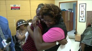 People Taking Action: Norfolk cheer coach, business owner honored for bigheart
