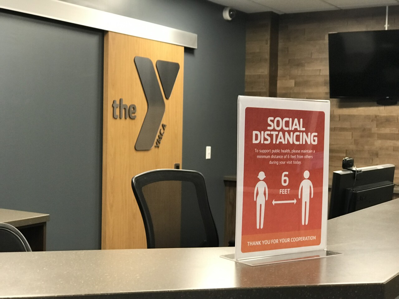 Signs promote social distancing at the YMCA